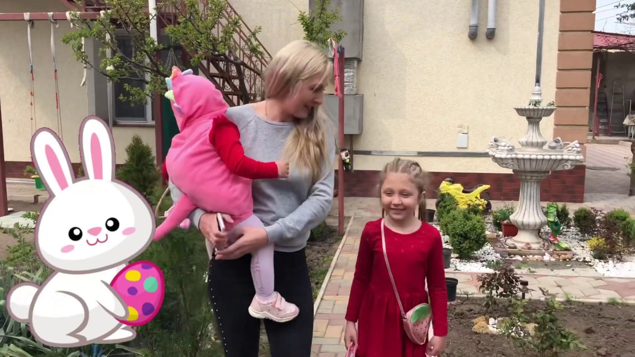 Julia and Eva play in garden and pick up chocolate eggs